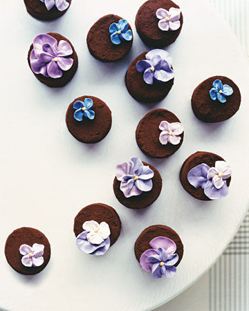 Tasty flower-topped purple cupcakes